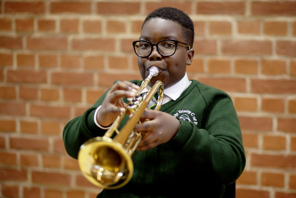 Photo of a boy playing the trumpet