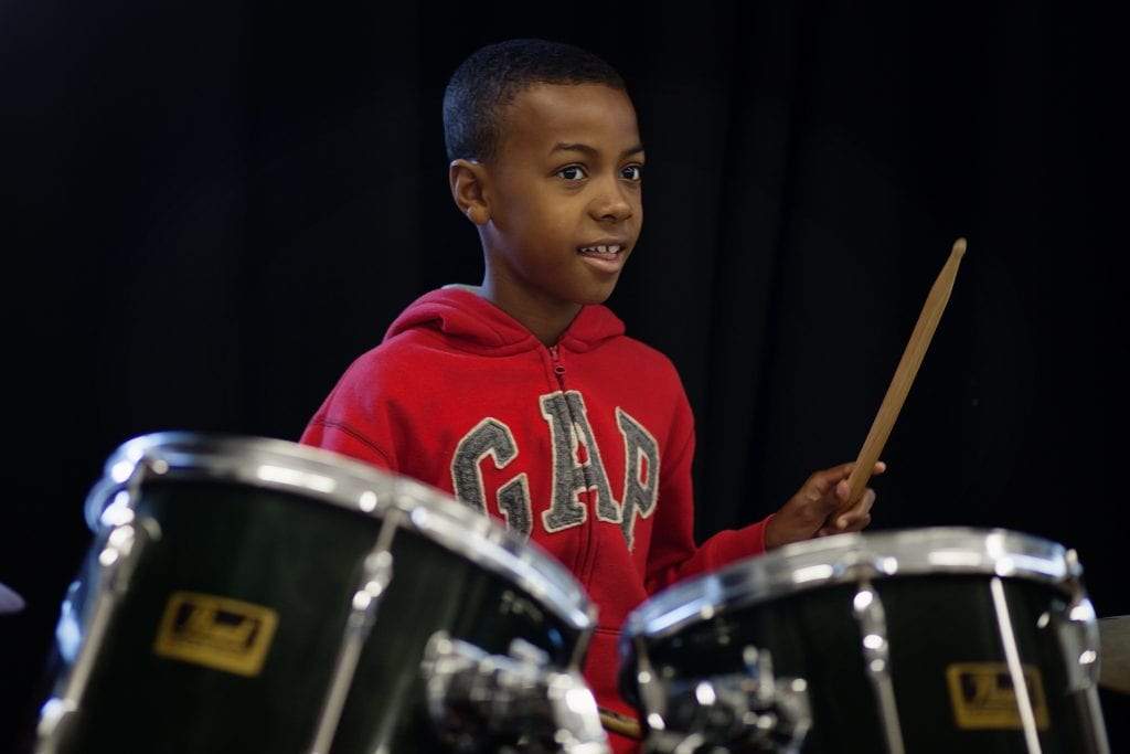 A boy playing the drums