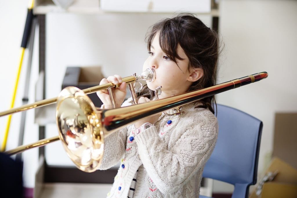A girl playing the tombone