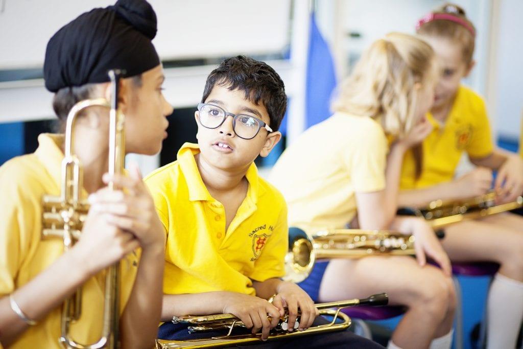 Children having a trumpet lesson in school.