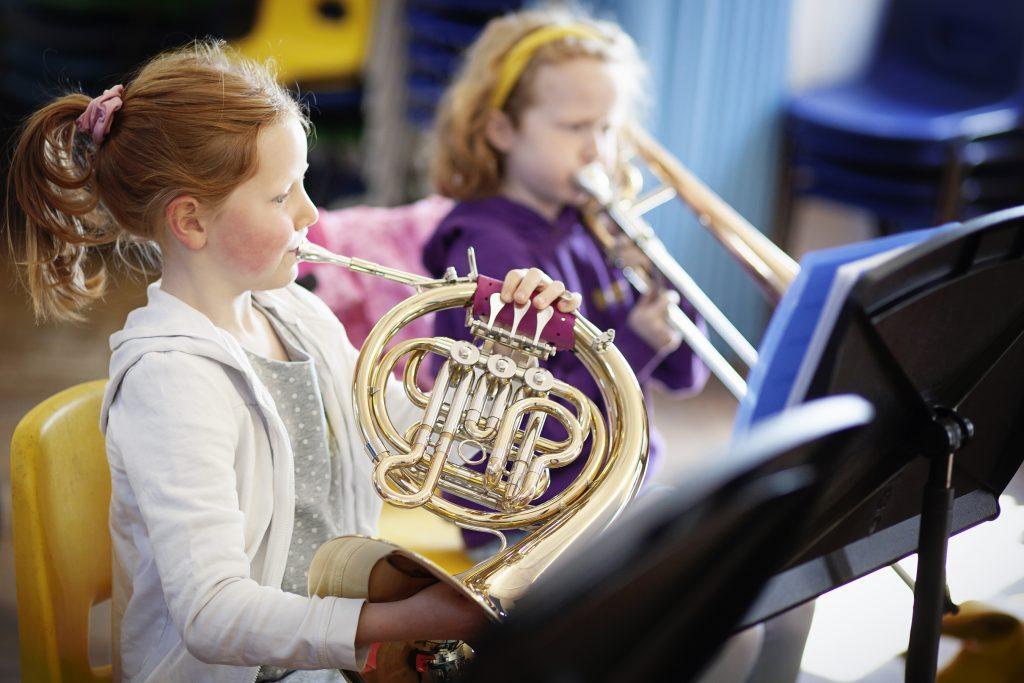 Children playing brass instruments in a junior Merton Music Foundation band